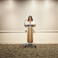 Japanese businesswoman standing at podium