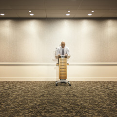Mixed race businessman standing at podium