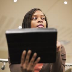 African American businesswoman using digital tablet