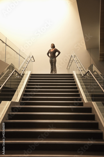 African American businesswoman standing on stairs