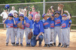 Coach and baseball players cheering after game
