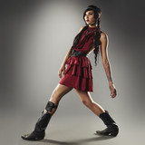 Trendy mixed race woman in cowboy boots