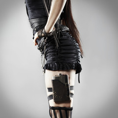 Trendy Caucasian woman with flask on leg