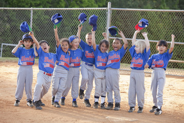 Baseball players cheering after game
