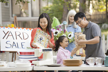 Asian family shopping at yard sale