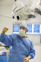 Surgeon gesturing in operating room