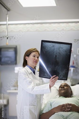 Doctor explaining x-ray to patient in hospital