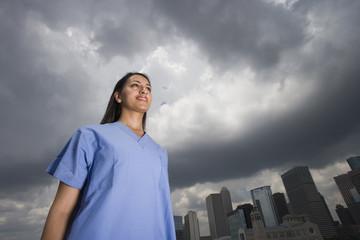 Doctor walking in urban setting