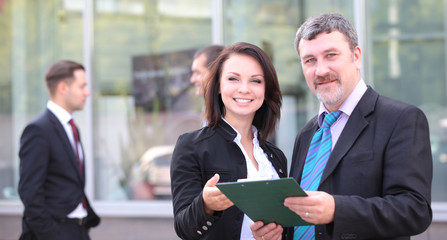 Image of two business partners planning work outdoors
