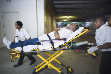 Medics transporting patient to hospital