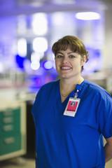 Caucasian nurse standing in hospital