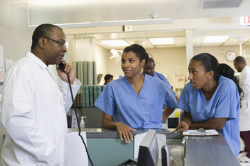Doctor and nurses working in hospital