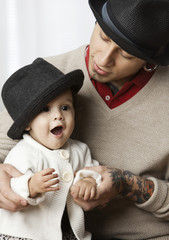 Hispanic father and daughter wearing fedora hats