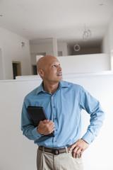 Hispanic architect examining renovation work