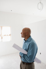 Hispanic architect examining renovation work