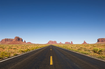 Highway and rock formations in desert