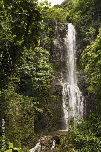 Remote waterfall in tropical rainforest