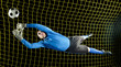 Caucasian soccer goalie jumping in mid-air catching ball at night