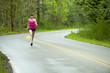 Mixed race woman running on remote road