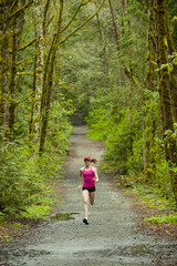 Mixed race woman running on remote path