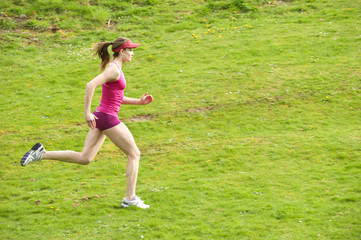 Mixed race woman running in field