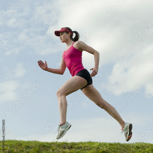 Mixed race teenager running outdoors
