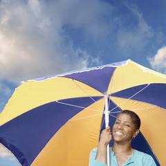 African American woman holding umbrella