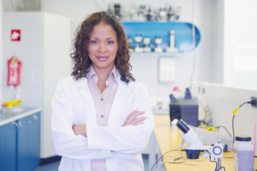 Mixed race scientist standing in laboratory