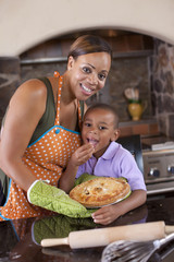 Mother and son baking pie together