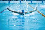 man swims the butterfly