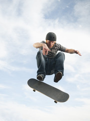 Caucasian man on skateboard in mid-air