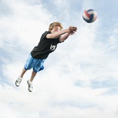 Caucasian teenager returning volleyball
