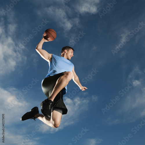 Caucasian man playing basketball