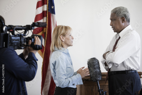 News reporter interviewing politician on camera