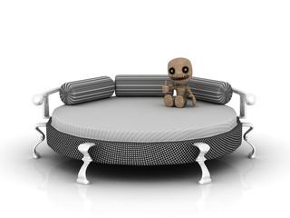 Rundes Bett mit Puppe
