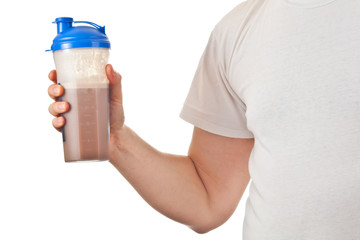 Man holding chocolate whey powder protein shake