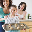 Family baking cookies together