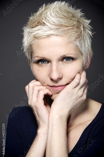 Blond woman with blue contact lenses