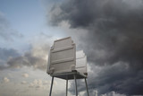 Voting booth against stormy sky