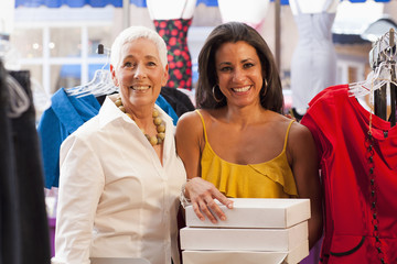 Women working together in dress shop