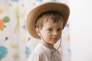 Caucasian boy wearing cowboy hat