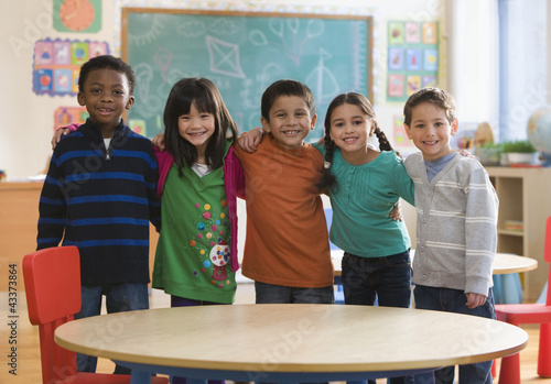 Students standing together in classroom