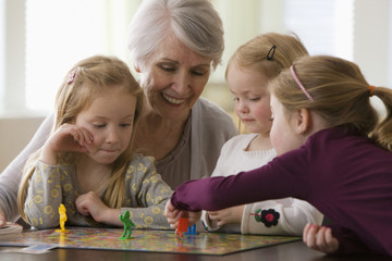 Caucasian grandmother and granddaughters playing game together