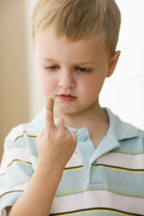 Caucasian boy with bandage on finger