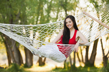 Caucasian woman laying in hammock