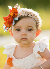 Caucasian baby with fashionable headband