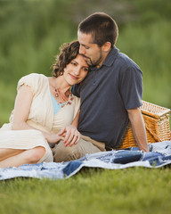 Caucasian couple enjoying picnic