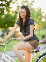 Caucasian woman sitting on bicycle