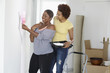 African American mother and daughter painting room