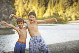 Boys playing near remote stream